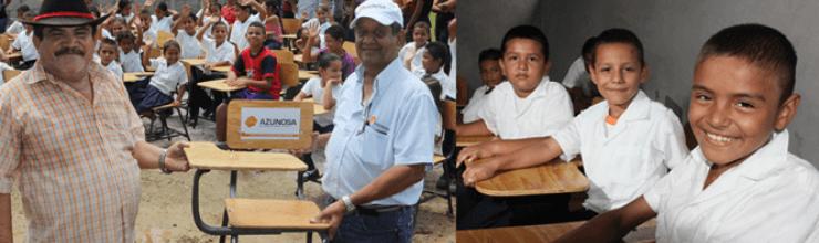 Azunosa cambia bloques por pupitres de escuela El Progreso